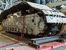 Technicians in the Vehicle Assembly<br /> Building are jacking crawler-<br /> transporter-2 four feet off the floor<br /> to facilitate removal of the roller<br /> bearing assemblies. After inspections,<br /> new assemblies will be installed.<br /> Photo credit: NASA/Charisse Nahser&nbsp;&nbsp; <br /> <a href='http://www.nasa.gov/images/content/738554main_Crawler%20Mods.jpg' class='bbc_url' title='External link' rel='nofollow external'>� View Larger Image</a>